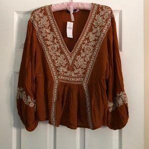 Burnt orange blouse